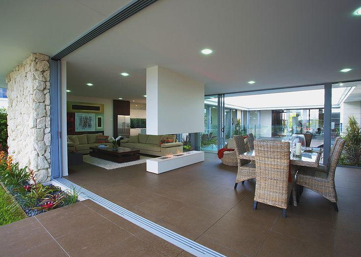 Stack sliding doors that disappear into the wall cavity bring the outdoors in, giving a much bigger living area.