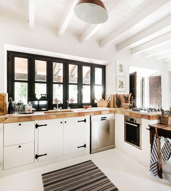 black windows white kitchen luggage hardware and butcher block counters