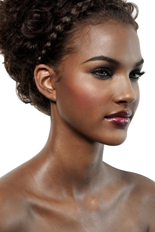 curly hair with a braid details very glamorous, and her skin is glowing
