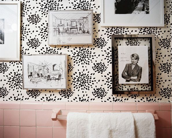 Sketches by Albert Hadley and a signed portrait of Martha Stewart on Hadley's fireworks-print wallpaper.