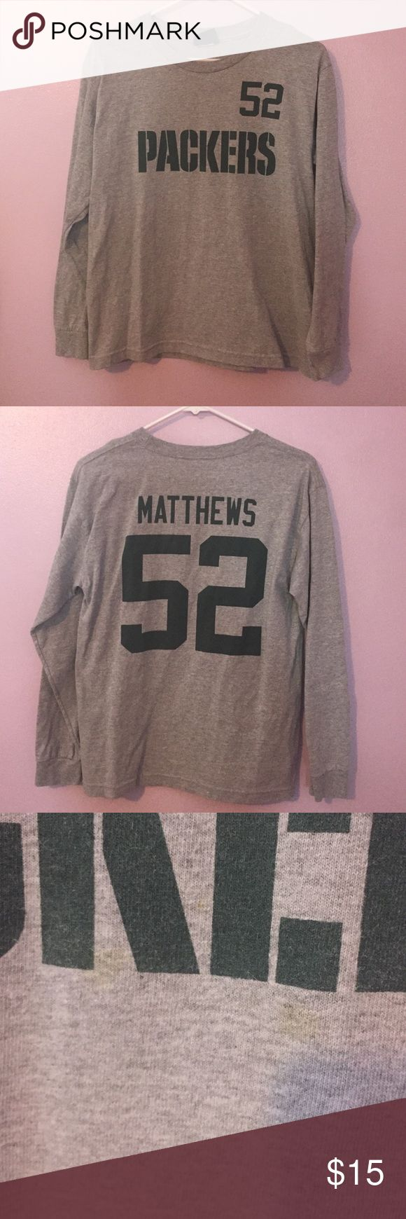 "Clay Matthews long sleep top Clay Matthews gray long sleeve top. Kids. Believe its a Medium-Large. Can fit a women's small. Two small spots (shown in last picture) Measurements: hem 19"" length 24 1/2"" NFL Tops"