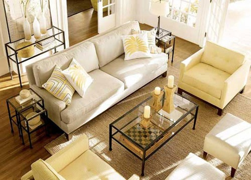 Love this living room - couch, tables, chairs, ottomans, neutral colors with white wood doors. Image originally from #PotteryBarn.
