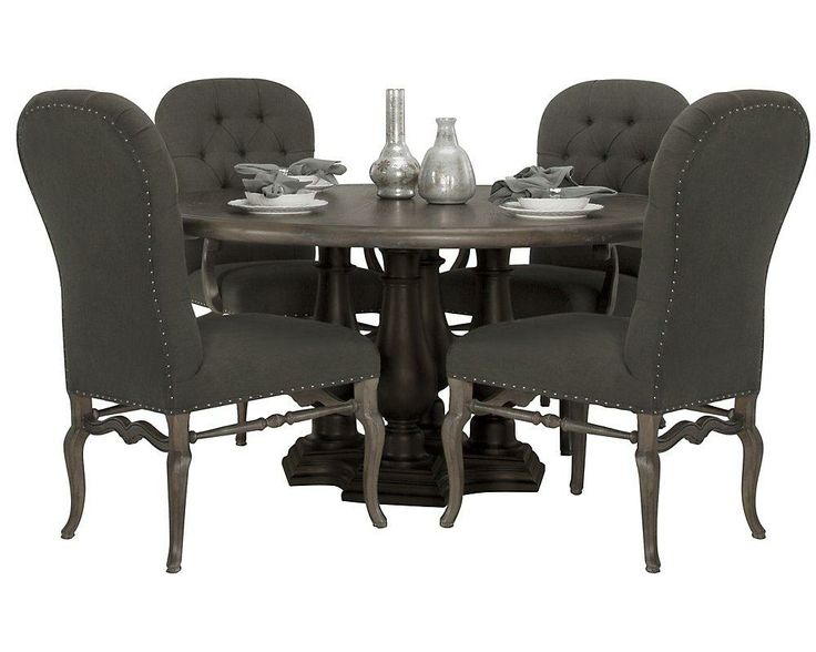 This Round Pedestal Table Features Dark Contrasting Legs That Accent The Rustic Oak Top Dining Room