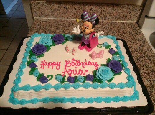 Cheap, easy and themed birthday cake. Take a $17 Sams Club cake and add a minnie mouse toy. #birthdaycake #minniemouse