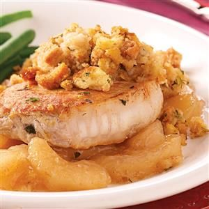 Pork Chops with Apples and Stuffing Recipe -The heartwarming taste of cinnamon and apples is the perfect accompaniment to these tender pork chops. This dish is always a winner with my family. Because it calls for only four ingredients, it's a main course I can serve with little preparation. —Joan Hamilton, Worcester, Massachusetts