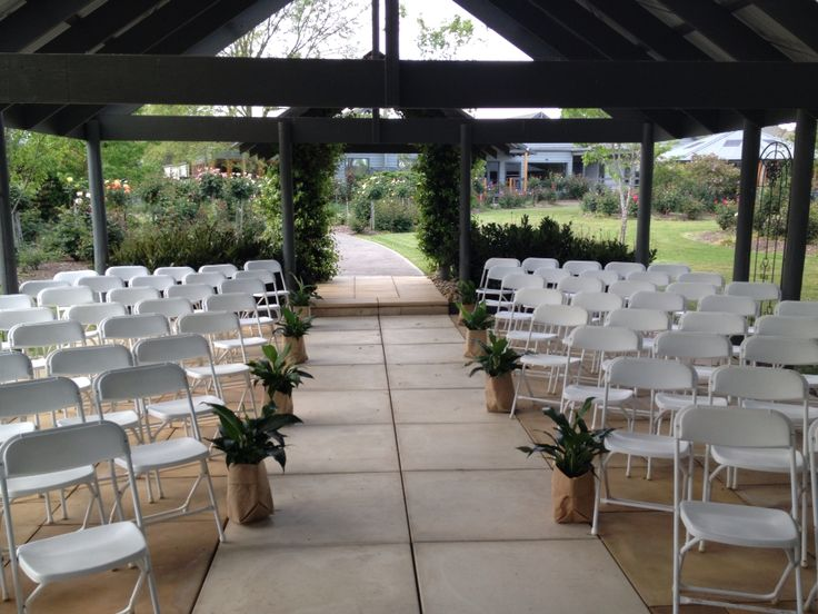 Rustic hessian bags with green plants add a simple touch to your outdoor ceremony.