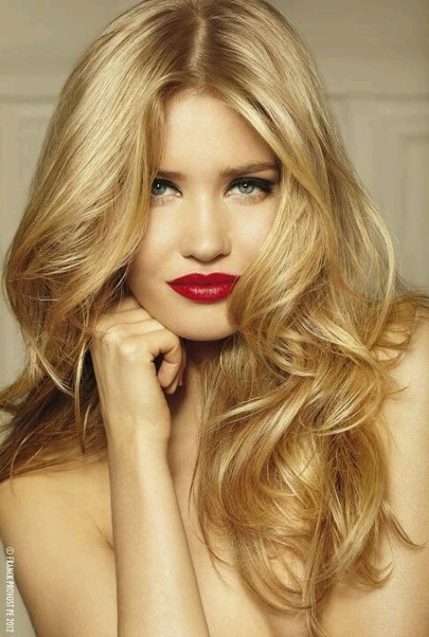 Golden blonde hair and highlights and red lipstick