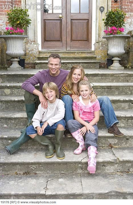photo images of a family of four posing | Family of four on steps, portrait
