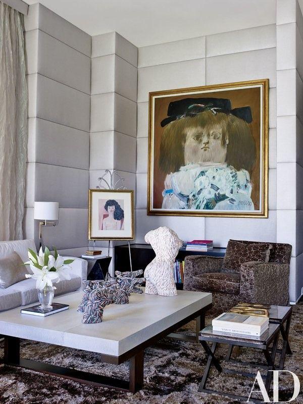 Paintings by Fernando Botero are displayed in the master suite's sitting area | archdigest.com