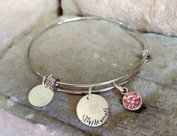 Bridesmaid Bracelet - Bridesmaid Gift - Bridal Party Bracelet - Maid Of Honor Bracelet - Bridesmaid Jewelry - Bridesmaid Charm Bracelet You just said yes to the man of your dreams. Now it is your turn to ask your best girls to be your Bridesmaids. Give her a token that she will wear long after your big day by asking her with this classy yet unique hand stamped Maid of Honor bangle bracelet. Custom Hand stamped Stainless Steel Expandable Bangle Bracelet (7in-9in).  **Small Disk (dime Sized)…