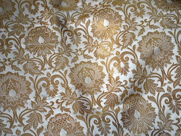 Brocade Fabric, indian brocade, Banaras silk, Silk Brocade Fabric. This is a beautiful pure heavy Banarasi silk brocade floral design fabric in Cream/Off white and Gold. The fabric illustrate...