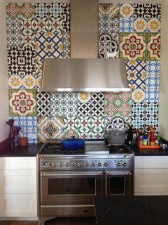 Cement Tiles create a beautiful and fun back splash in this kitchen.