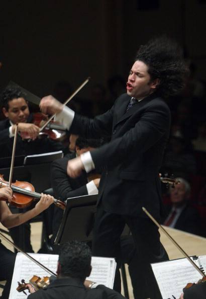Venezuelan conductor, Gustavo Dudamel.  Tap to see him conduct the Simon Bolivar Symphony Orchestra - Danzon #2