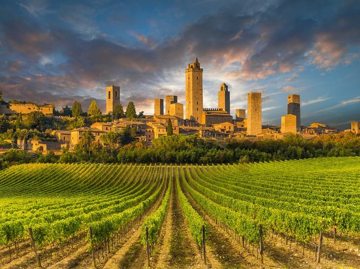 It's impressive medieval skyline, which is visible for miles as you approach, charms from a distance, but once you're seated at a café in this tiny Tuscan town, sipping a glass of Vernaccia and snacking on salumi—that's when the real love affair begins.