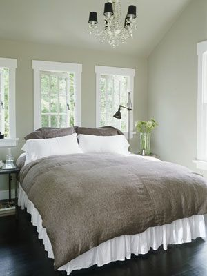 Beautiful, soothing room.  I really like how they framed the windows with simple, white.
