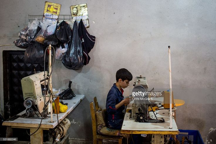 A young Syrian refugee boy makes shoe parts in a Turkish owned factory on May 16, 2016 in Gaziantep, Turkey. Since fleeing the war and after the new E.U - Turkey deal effectively shutting down routes to Europe for many Syrian refugees, living in Turkey has become their only option, however there is very little stable work and little hope of building a future. Turkey's massive and largely unregulated garment industry is an attractive option for Syrians to work both legally and illegally…