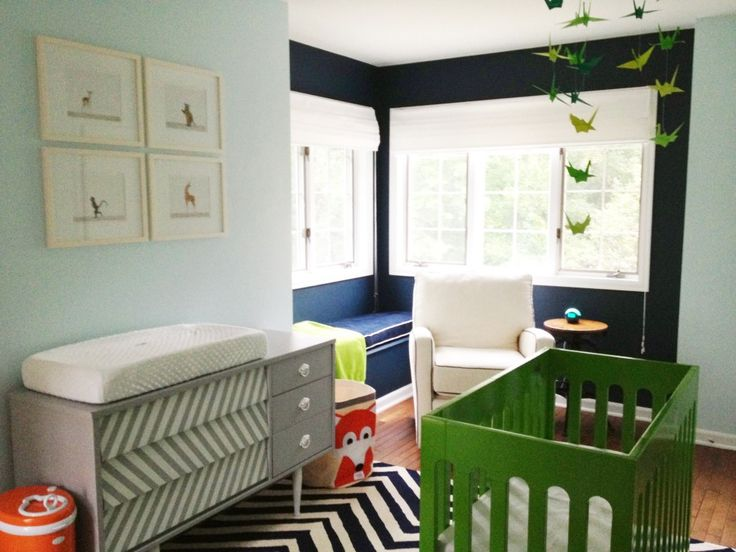 Love this navy nook and herringbone changing table in this colorful nursery! #nursery #nurserydecor