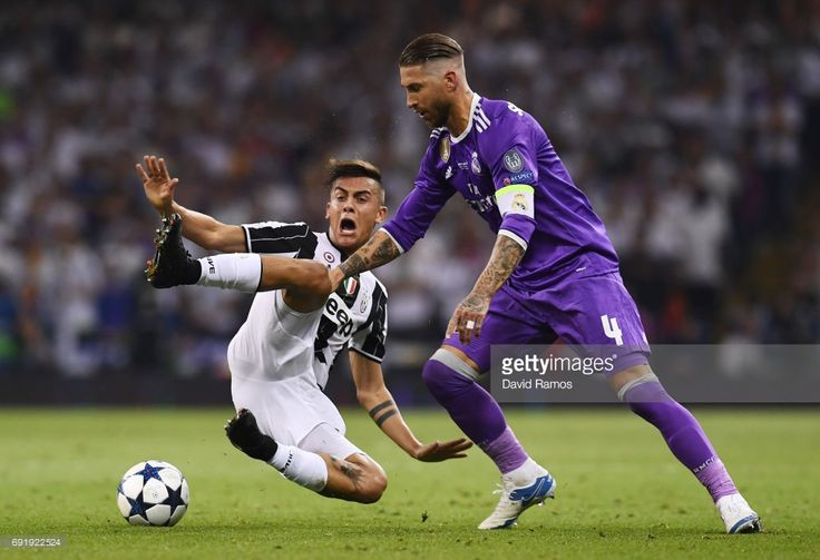 Paulo Dybala of Juventus and Sergio Ramos of Real Madrid battle for possession during the UEFA Champions League Final between Juventus and Real Madrid at National Stadium of Wales on June 3, 2017 in Cardiff, Wales.