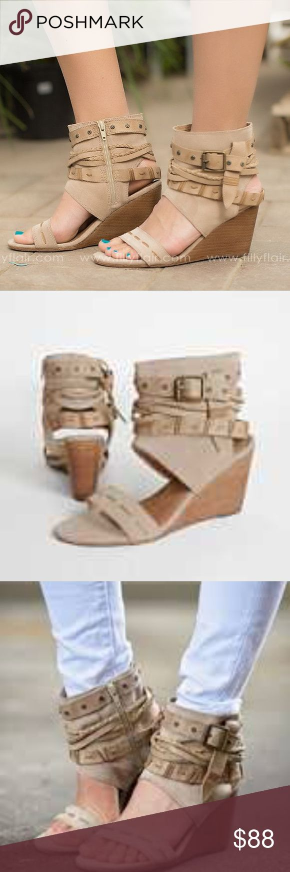 """Naughty Monkey Lasalle This sandal's collection of wraparound straps send a bold bohemian message     Leather upper     Side zipper for easy on and off     Lightly cushioned footbed     3"""" wedge heel naughty monkey Shoes Wedges"""