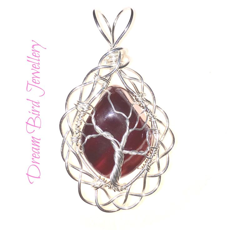 Designed and hand crafted by Dream Bird Jewellery this sterling silver pendant features an richly coloured piece of carnelian. I have worked a tree of life into the front of the pendant. Carnelian ...