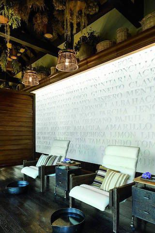 The manicure and pedicure room at Spa Botánico in Dorado Beach, a Ritz-Carlton Reserve, features wall art that displays the names of natural elements indigenous to the island of Puerto Rico.