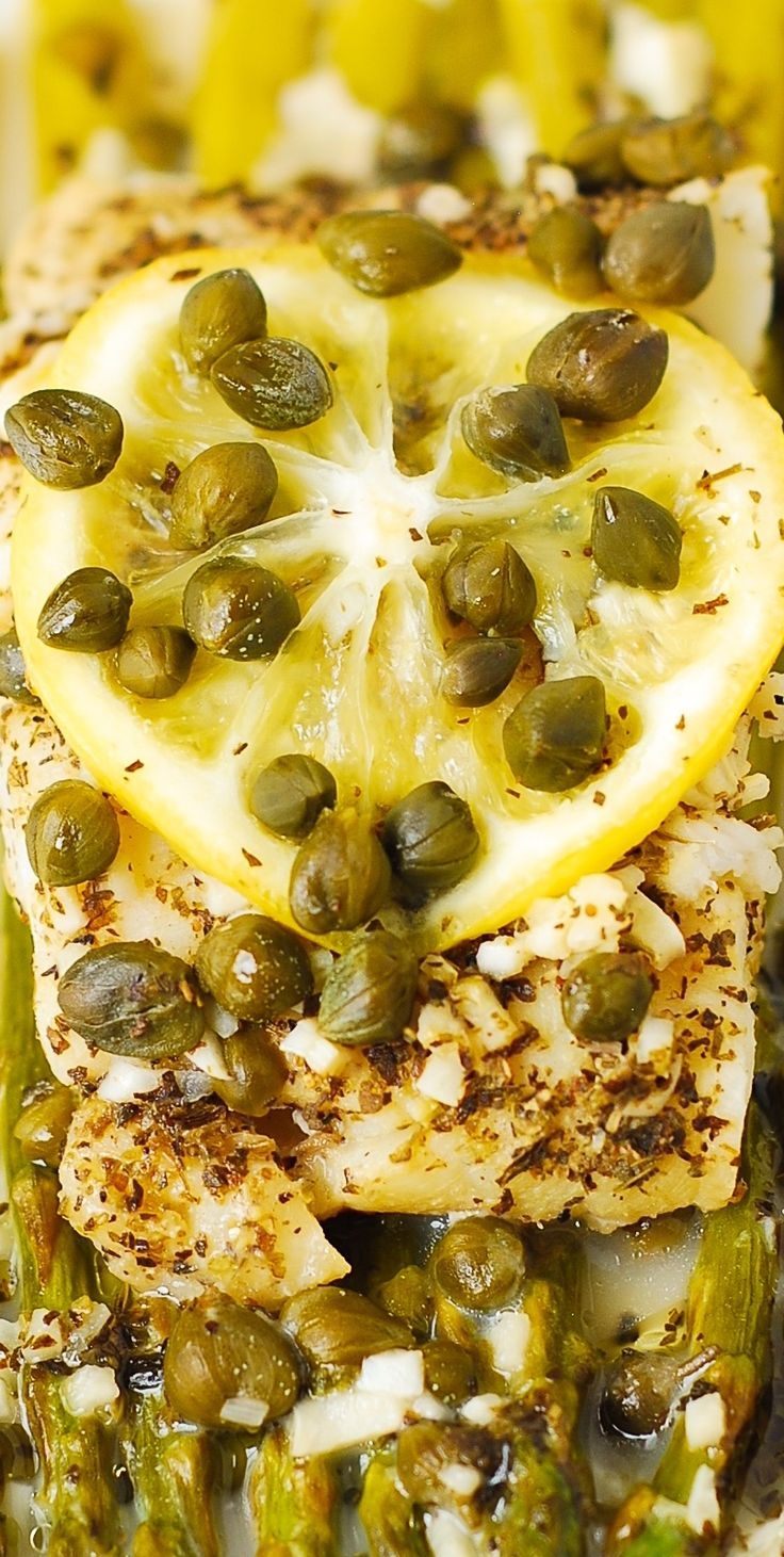 Pacific Cod and Asparagus with Garlic Lemon Caper Sauce baked in foil! A delicious and easy recipe to cook any white fish - Pacific Cod (on photos), tilapia, halibat, mahi mahi, sea bass, etc. Healthy, low carb, gluten free recipe!