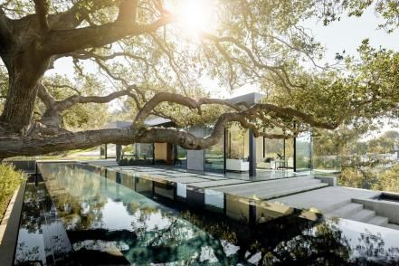 HGTV presents an expansive modern home with a gorgeous infinity pool, built into a hillside and surrounded by majestic oak trees.