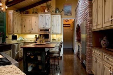 Love love this kitchen-colors, accents, above cupboard decor, brick.  Great space.  Country Decorating Catalogs here too.