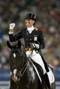 The Netherlands' Anky Van Grunsven celebrated a hat-trick of back-to-back Individual Olympic titles at the Beijing 2008 equestrian events in Hong Kong. She is pictured riding double Olympic champion Salinero who will line out once again at London 2012