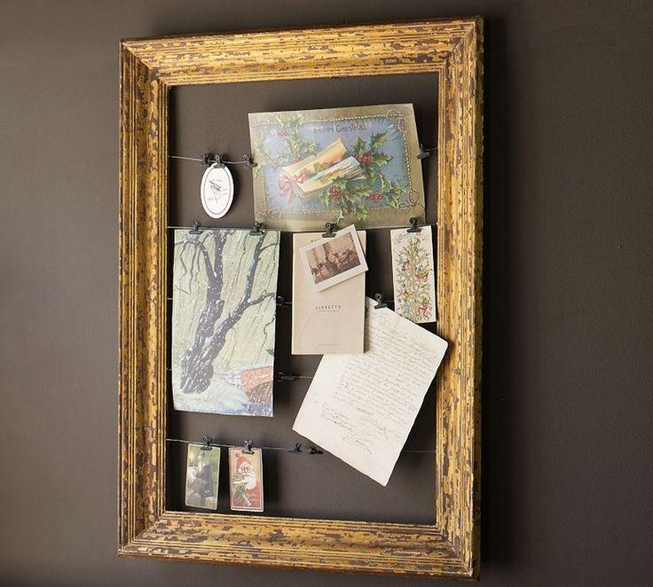 Old frame + metallic paint + wire coat hangers + metal clips = new way to