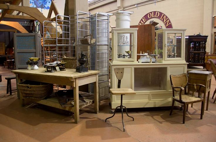 Vintage French cake display cabinet, French baker's preparation table, industrial stool.