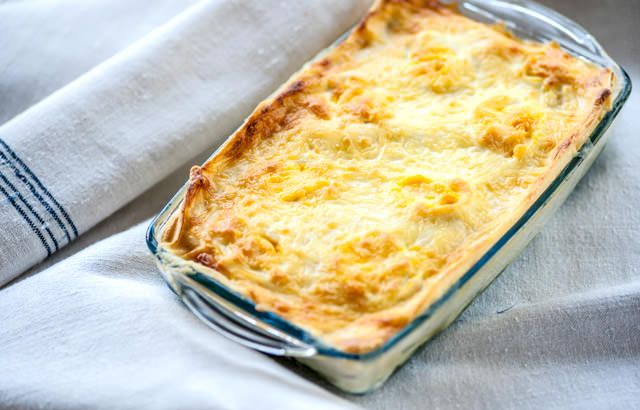 Layers of spinach, fish and cheese make up this homely lasagne recipe from Mark Dodson