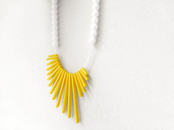geometric asymmetrical tribal necklace with yellow by pergamondo