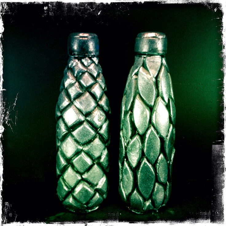 Water bottle made of a plastic soda bottle, foam, glue and paint. Keeps the water cold.