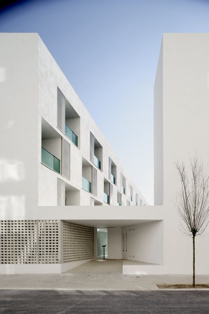 Love the simplicity of this stunning cubist white apartment complex in Barcelona.