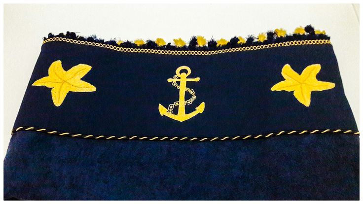 Navy embroidered beach towel with tassels