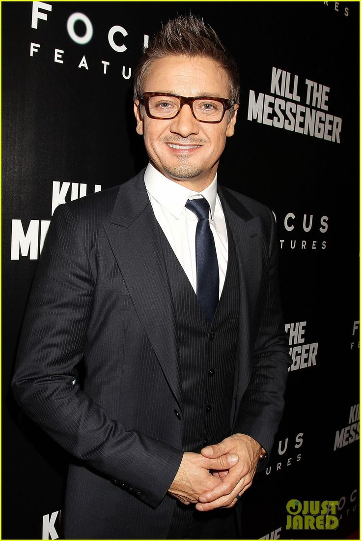 Jeremy Wearing Black Pinstriped Suit and Tie and White Button-Up Shirt and Glasses at  Premiere of Kill The Messenger