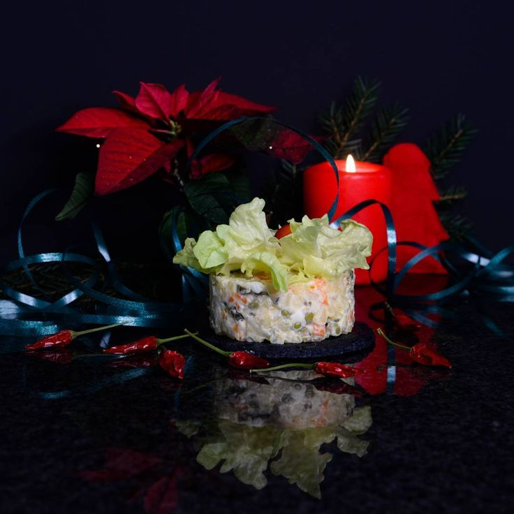 This THE most typical Russian salad for any celebration, it's called Olivier . There are a lot of variations nowadays, but as we cook it only once a year for New Year's Eve, we follow the most standard recipe