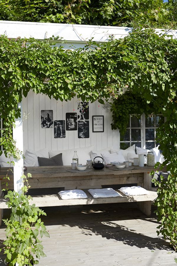 Lovely naturally shady place to eat in the garden. Like the black and white…