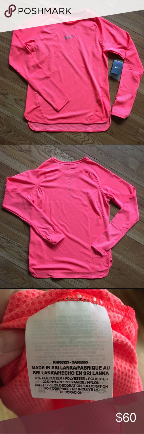NWT Nike Running Dri Fit Neon Long Sleeve Shirt NWT Nike running neon orange/pink color long sleeve shirt. Most accurate color representation is in last picture of the tag!   No trades or modeling 🚫 Smoke free but pet friendly home 🐶🐱 Please use offer button, no low balls! 💋 Nike Tops Tees - Long Sleeve