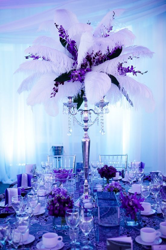 Purple and white center pieces with feathers