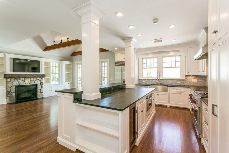 Nice!  Traditional Kitchen with Slate counters, Columns, L-shaped, Kitchen island, Exposed beam, Ceramic Tile, Hardwood floors