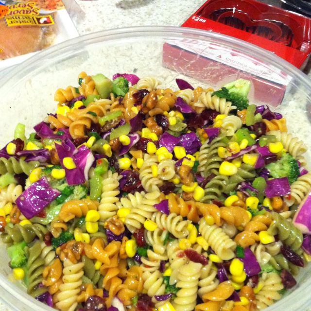 Mardi Gras Pasta Salad...I wish there was a recipe for this, but it looks to be tri-colored pasta, corn, red cabbage and broccoli. Is toss it in Italian dressing.