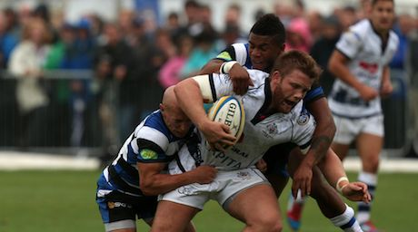 Hooker Rhys Lawrence looks to escape the attentions of Peter Stringer on Saturday