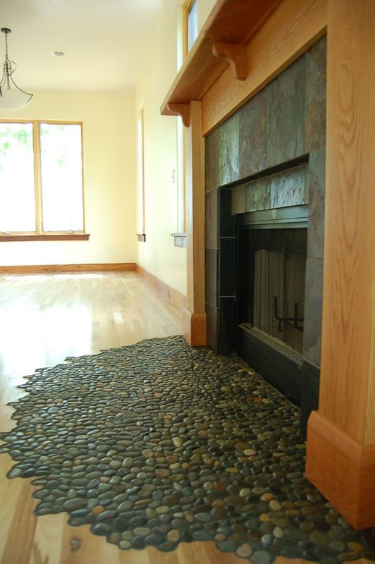 Amazing tiling idea using Glazed Bali Ocean Pebble tile for fireplace hearth.