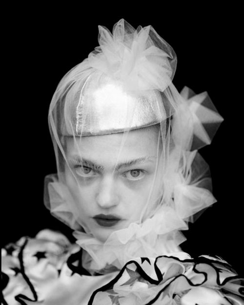 sheer white material as head piece inspiration
