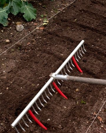 Use a rake with tubing attached to mark rows for planting