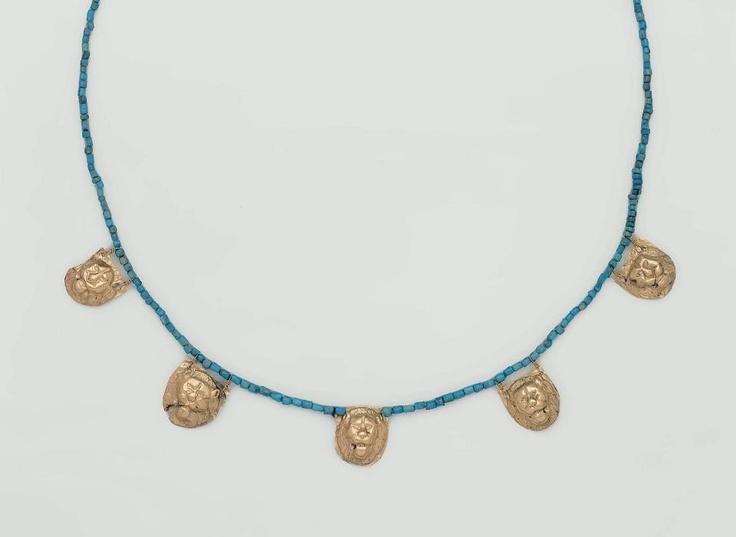 This necklace is composed of five repoussee gold lion heads strung among modern turquoise cylinder and ring beads. There are two suspension loops at the top of four lion heads. One lion has no suspension loops. Gold, glass (modern); Egyptian, Hellenistic Period (Ptolemaic Dynasty), 305–30 B.C.