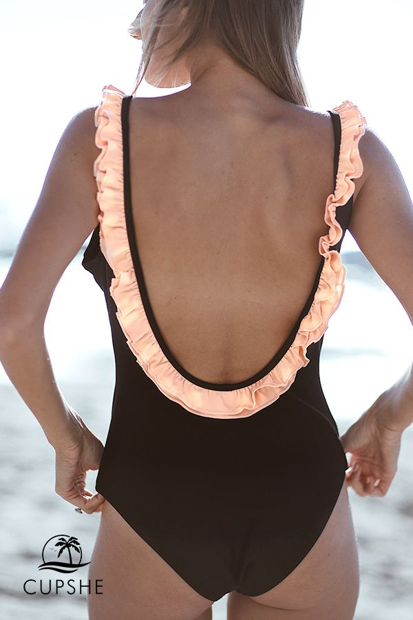 7fbac63e49938 Deep v-neck front and deep scoop back deliver feminine grace. Fabulous  combination of black one-piece and PINK ruffle.  CUPSHE  black  swimwear   holiday   ...