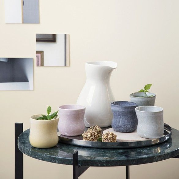 The popular cups and jugs have been given new glazes in modern, subdued colours to create an informal elegance.